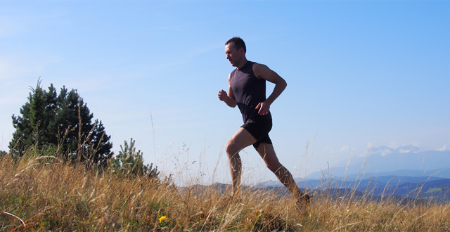 Picture of an athletic man jogging in the outdoors